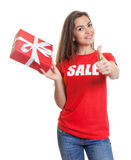 Woman with long brown hair and gift sale in shirt Stock Photos