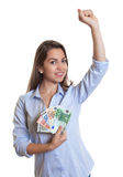 Woman with long brown hair is happy about her money Stock Image
