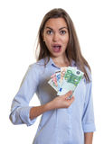 Woman with long brown hair presenting money Stock Photos