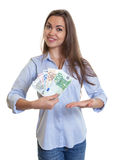 Woman with long brown hair shows money Stock Images