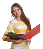 Woman with long brown hair and some records in her hand Stock Photography