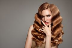 Portrait of woman with long curly beautiful ginger hair. Royalty Free Stock Photos