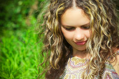 Woman with long curly hair #1. Young pretty woman with long curly hair Royalty Free Stock Images