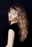 Woman with long curly hair royalty free stock photos