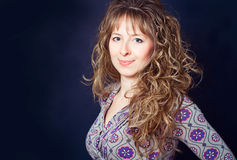 Woman with long curly hair Royalty Free Stock Images