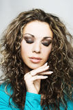 Woman with long curly  hair. Portrait of young woman with long curly  hair and with closed eyes Stock Photos
