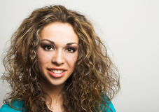 Woman with long curly  hair Stock Photos