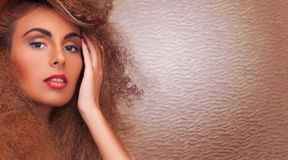 Woman with long curly hair Stock Images