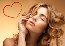 Woman with long curly hair and closed eyes Stock Images