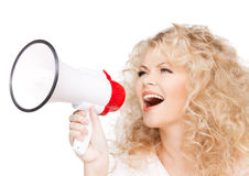 Woman with long curly hair holding megaphone Stock Image