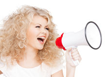Woman with long curly hair holding megaphone. Health and beauty concept - beautiful woman with long curly hair holding megaphone royalty free stock images