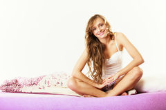 Woman long curly hair relaxing on bed at morning Stock Images