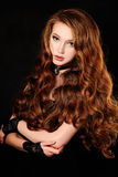 Woman with Long Curly Red Hair Stock Images