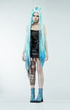 Woman with long cyan hair. Woman with long cyan wig royalty free stock photo