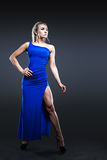 Woman in long dark blue dress Royalty Free Stock Photography