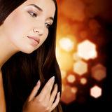 Woman with long dark hair Stock Images