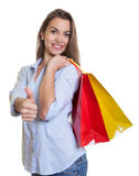 Woman with long dark hair loves and shopping Stock Photos