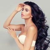 Woman with Long Dark Hair and Natural Makeup. Cute Fash Royalty Free Stock Photos