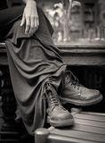 Woman with Long Dress and Boots royalty free stock image