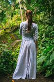 Woman in long dress enjoys nature view in Bali. Indonesia Stock Photography