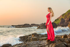 Woman in long dress in front of sea Royalty Free Stock Photos