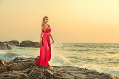 Woman in long dress in front of sea royalty free stock photo