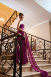 Woman in a long dress lying on the stairs Royalty Free Stock Photo
