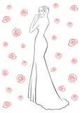 Woman in a long dress among roses Stock Photos