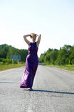 Woman in long evening dress Stock Image