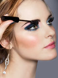 Woman with long eyelashes and mascara stock photography