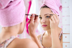 Woman  with long eyelashes and mascara brush Stock Photography
