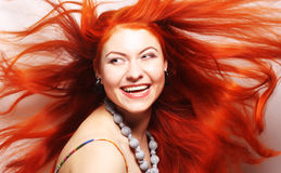 Woman with long flowing red hair Stock Images