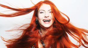 Woman with long flowing red hair Stock Photos