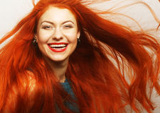 Woman with long flowing red hair Stock Photo