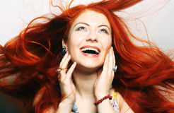 Woman with long flowing red hair Royalty Free Stock Images