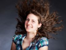 Woman with long flying hair Stock Photo