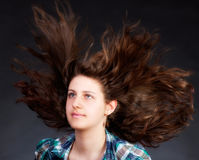 Woman with long flying hair Stock Photography