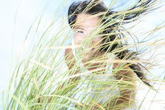 A Woman with Long Grass Royalty Free Stock Images