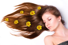 Woman with long hair. Young beautiful woman with yellow flowers in hair Stock Photo