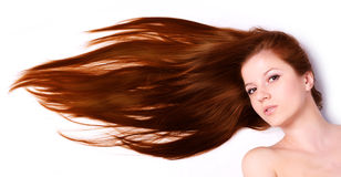 Woman with long hair. Young beautiful woman with long brown hair Stock Image