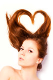 Woman with long hair. Portrait of woman with long hair in shape of heart Royalty Free Stock Image
