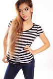 Woman with long hair and bright makeup wears casual clothes Stock Photography