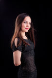 Woman with long hair in dark cloth Royalty Free Stock Image