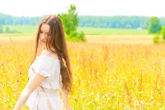 Woman with long hair in field Stock Photos
