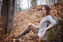 Woman with long hair in forest in autumn season Royalty Free Stock Images