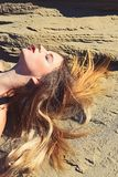 Woman with long hair, hairstyle relax on sand stock images
