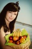 Woman long hair holding basket fruits summer Stock Image