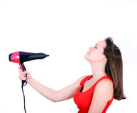 Woman with long hair holding strong blow dryer isolated on white Stock Image