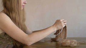 Woman with long hair knitting stock footage