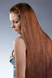 Woman with long hair looking down Stock Photo